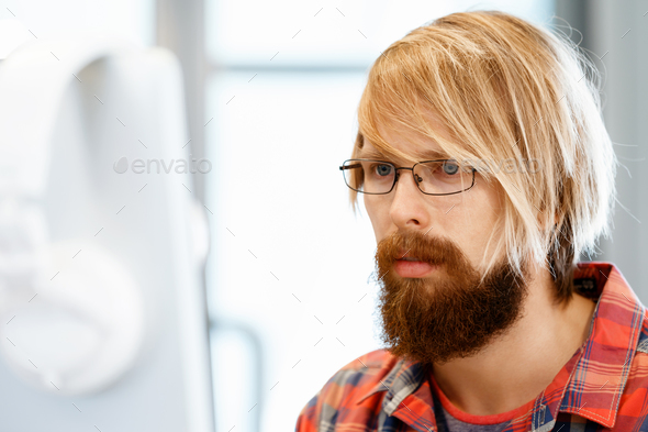 Handsome businessman in office - Stock Photo - Images