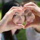 Young Couple Make a Heart Out Of Hand - VideoHive Item for Sale