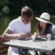 The Couple Drinking Coffee Near The River - VideoHive Item for Sale