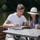 Man And Girl Drinking Coffee Near The River - VideoHive Item for Sale