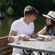 The Couple Looking Map Near The River - VideoHive Item for Sale