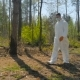 A Guy In a Special Suit Removes Trash In Forest - VideoHive Item for Sale