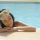 Woman In Snorkel And Goggles Rests By Pool - VideoHive Item for Sale