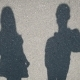 Shadow Man's And Girl's Over Asphalt - VideoHive Item for Sale