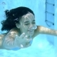 Young Woman Swimming Underwater With Closed Eyes - VideoHive Item for Sale