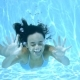 Happy Young Woman Smiling Underwater - VideoHive Item for Sale