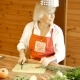 An Old Woman Slices Carrots And Answers The Phone. - VideoHive Item for Sale