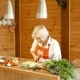 An Old Woman In The Kitchen Slicing Carrots. - VideoHive Item for Sale