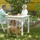Elderly Couple Playing a Board Game In The Garden. - VideoHive Item for Sale
