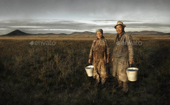 Mongolian Couple Farmers Holding Basin And Posing In The Field - Stock Photo - Images