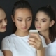 Three Girls Watching Photos On Smartphone In Studio - VideoHive Item for Sale