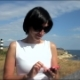 Teen Girl Using Smartphone On The Beach. Lighthouse - VideoHive Item for Sale
