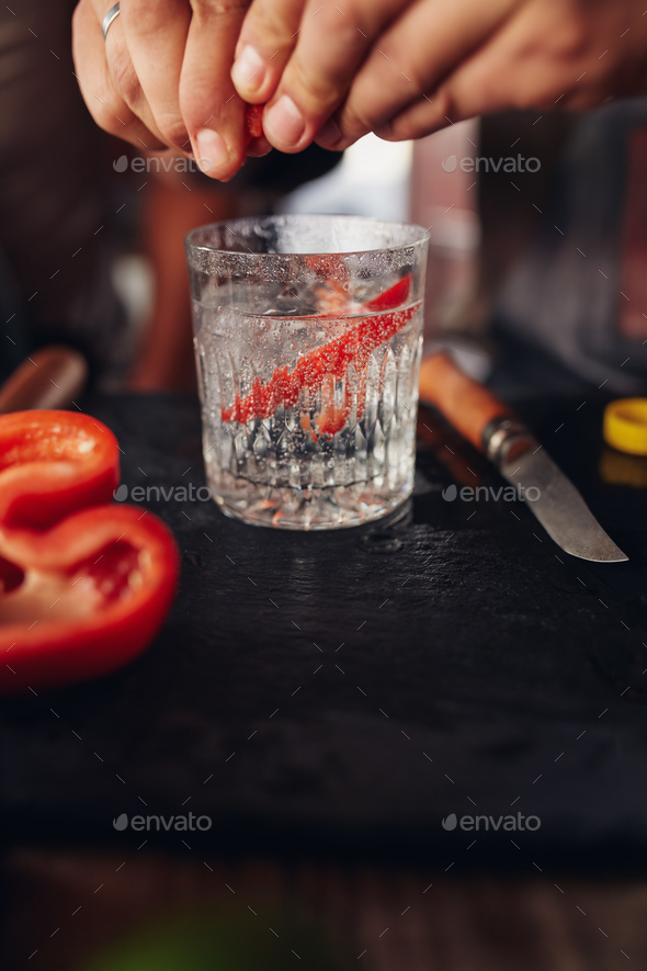 Bartender hands preparing cocktail - Stock Photo - Images