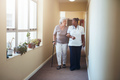 Healthcare work helping female patient. - PhotoDune Item for Sale