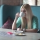 Blonde Drinking Coffee And Looking At Her Watch. - VideoHive Item for Sale