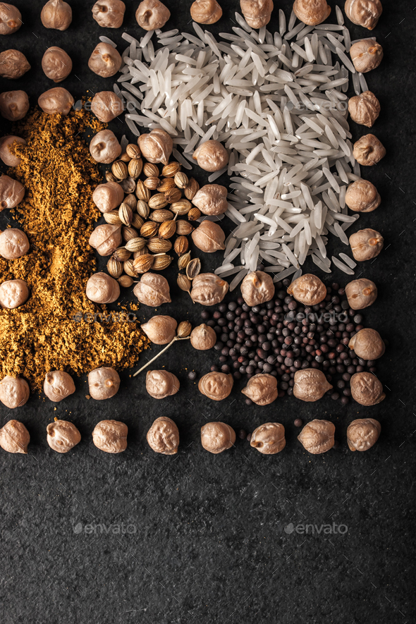 Composition of chick-peas  , rice and spice on the dark stone vertical - Stock Photo - Images