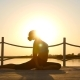 Slim Woman Doing Yoga Over Orange Sun - VideoHive Item for Sale