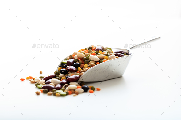 Mixed raw legumes in a metallic scoop - Stock Photo - Images