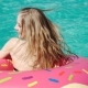 Young Hipster Millennial Girl In Sprinkled Donut Float At Pool, Festival, Party, Hotel, Beach, Event - VideoHive Item for Sale