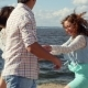 Girl Calls Friends Dancing On Summer Beach - VideoHive Item for Sale