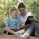 Mother And Son Using Tablet PC In The Forest - VideoHive Item for Sale