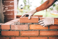 professional construction worker laying bricks and building barbecue in industrial site - PhotoDune Item for Sale