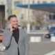 The Young Man Goes On The Parking And Speaks By Phone - VideoHive Item for Sale