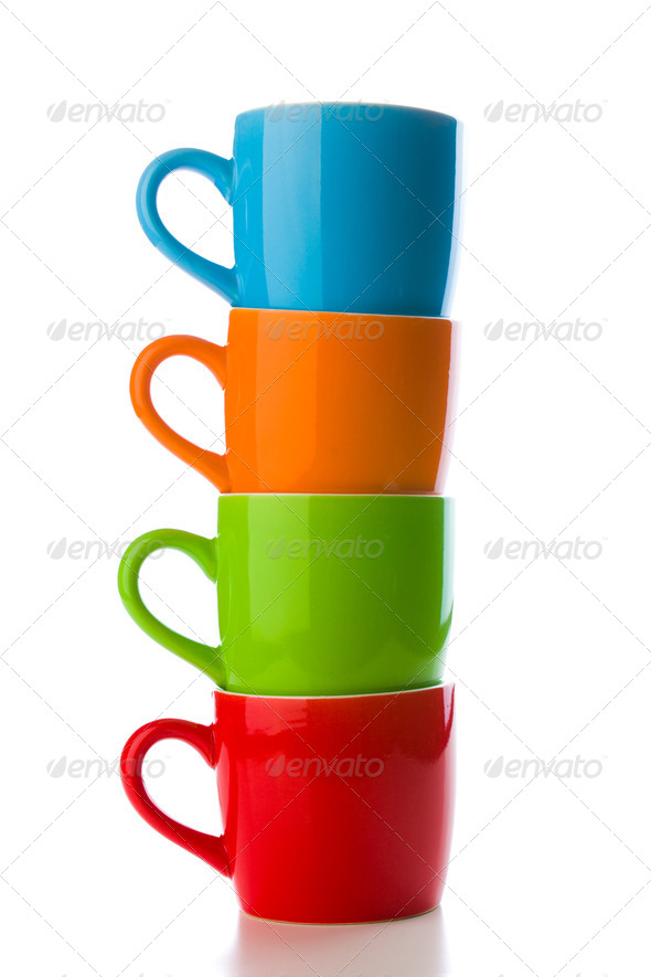 pile of colorful ceramic mugs - Stock Photo - Images