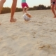 Family Playing Football. In The Frame Of The Man Legs Hit The Ball The Ball On The Sand - VideoHive Item for Sale