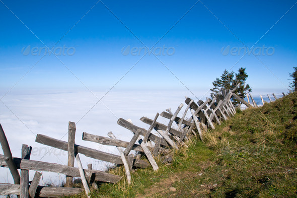 Wooden fence in the alps - Stock Photo - Images