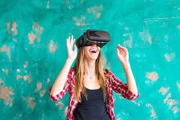 024ef914f2dc woman getting experience using VR-headset glasses of virtual reality -  Stock Photo - Images