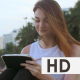 Woman Enjoying Using Tablet on the Beach - VideoHive Item for Sale