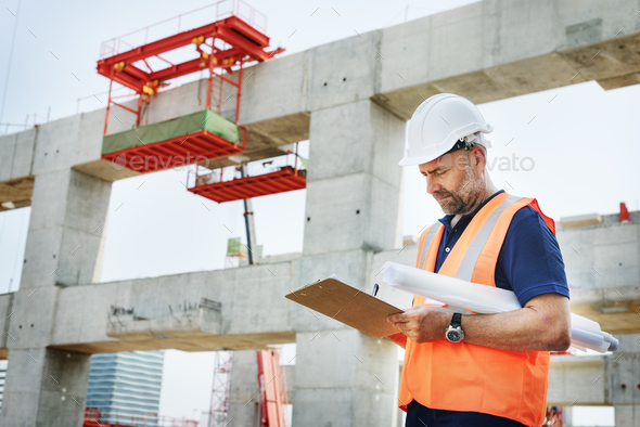 Construction Site Engineerer Working Blueprint - Stock Photo - Images