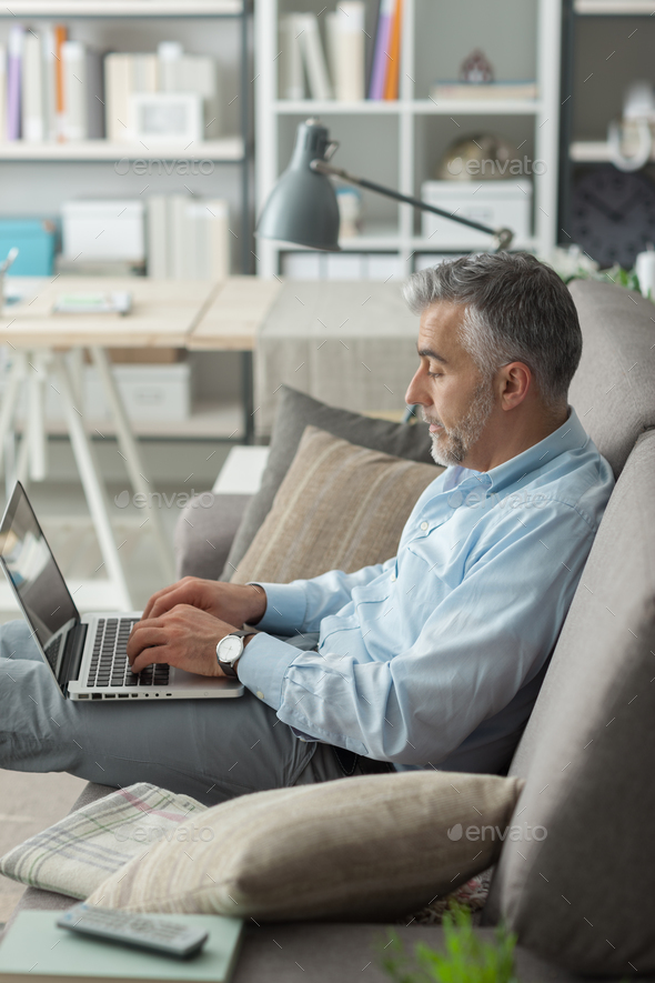 Businessman working at home - Stock Photo - Images
