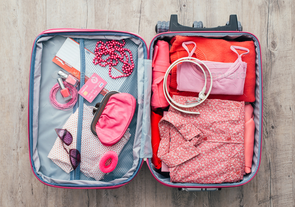 Woman getting ready to leave - Stock Photo - Images