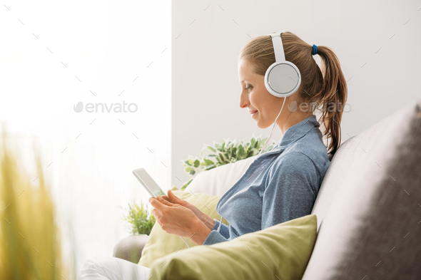 Woman using a tablet - Stock Photo - Images