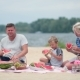 Happy Family Eating Watermelon On The Beach - VideoHive Item for Sale