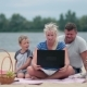 Family Using Laptop To Talk To Grandmom - VideoHive Item for Sale