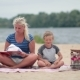 Mother Reading Book To Cute Son At The Beach - VideoHive Item for Sale