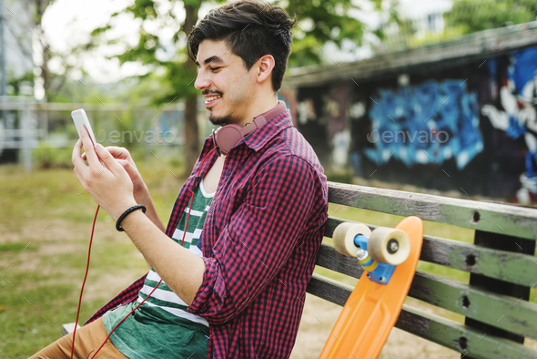 Teenager Boy Texting Skateboard Concept - Stock Photo - Images