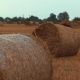 Field With Straw Bales Under Sunset Sky - VideoHive Item for Sale