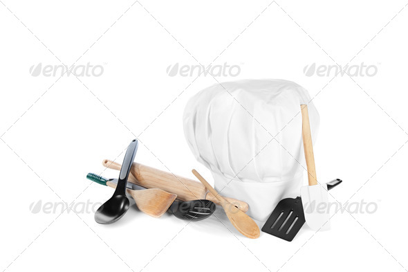 Chef's hat with cooking utensils - Stock Photo - Images
