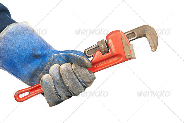 Man holding plumbers wrench - Stock Photo - Images