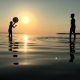 Children Playing Ball In The Water At Sunset. - VideoHive Item for Sale