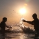 Children Spray Water At Sunset - VideoHive Item for Sale