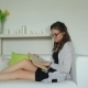 Cute Girl Relaxing On Sofa Reading Book - VideoHive Item for Sale
