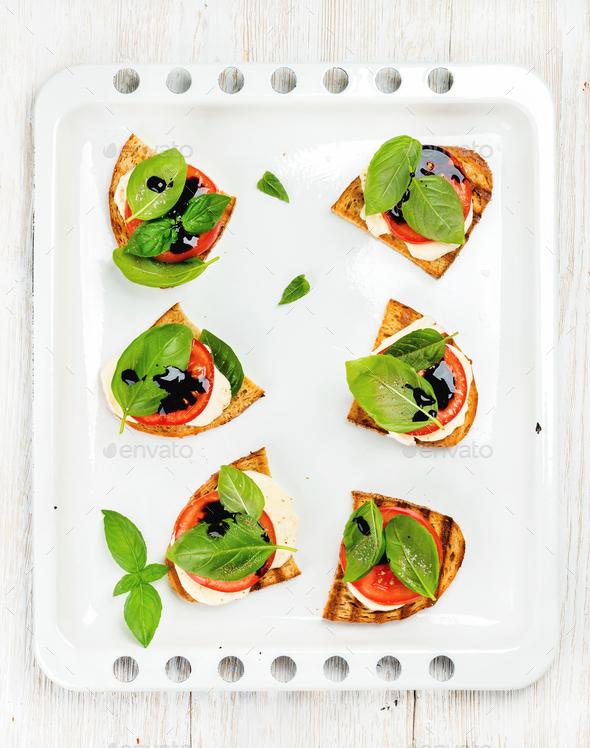 Caprese sandwiches with tomato, mozzarella cheese, basil and balsamic glaze - Stock Photo - Images