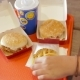 Female Hand Eating Fast Food - VideoHive Item for Sale