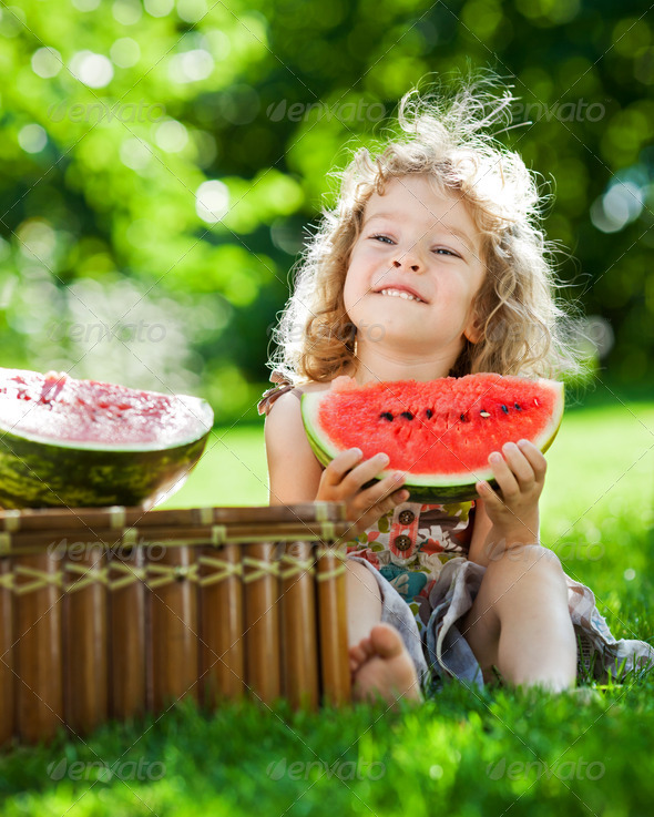 Child having picnic in spring park - Stock Photo - Images