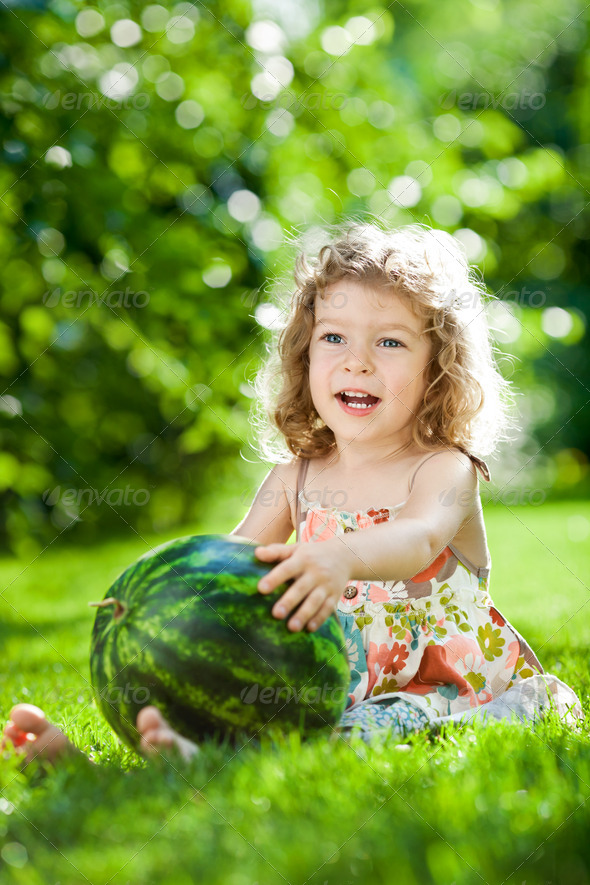 Child having picnic outdoors - Stock Photo - Images
